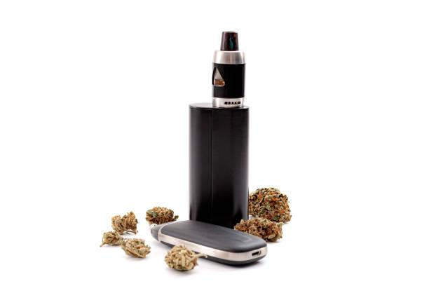 CBD and THC vaping products, dry herb vaporizer and healthy inhaling of cannabis concept theme with e cigarette and vape mod surrounded by marijuana buds isolated on white background CBD and THC vaping products, dry herb vaporizer and healthy inhaling of cannabis concept theme with e cigarette and vape mod surrounded by marijuana buds isolated on white background cbd vape stock pictures, royalty-free photos & images